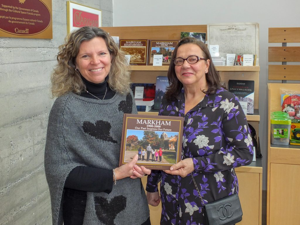 Friends of Markham Museum Board members Wendy and Athena with the Markham 1900-2000 book.